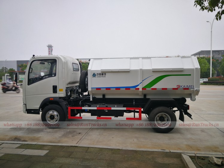 China Sinotruk 3 cbm hook arm garbage truck 05.jpg