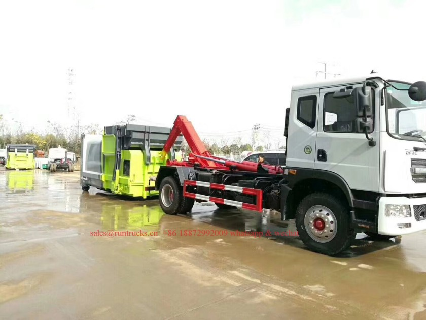 China hook arm garbage truck with Compressed Garbage station 01