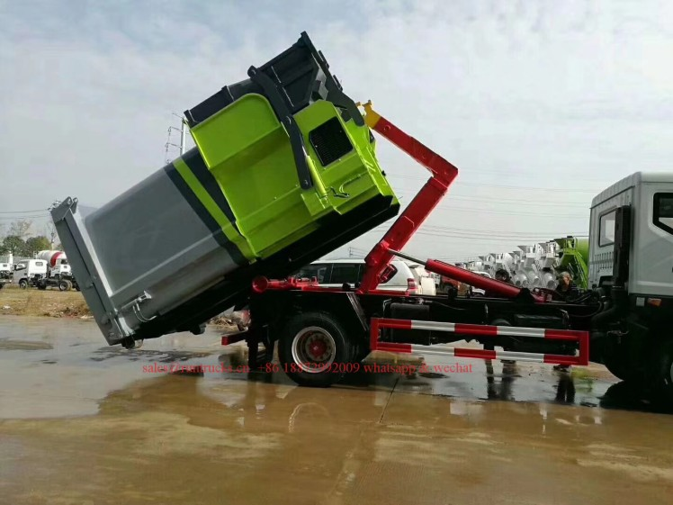 China hook arm garbage truck with Compressed Garbage station 07.jpg