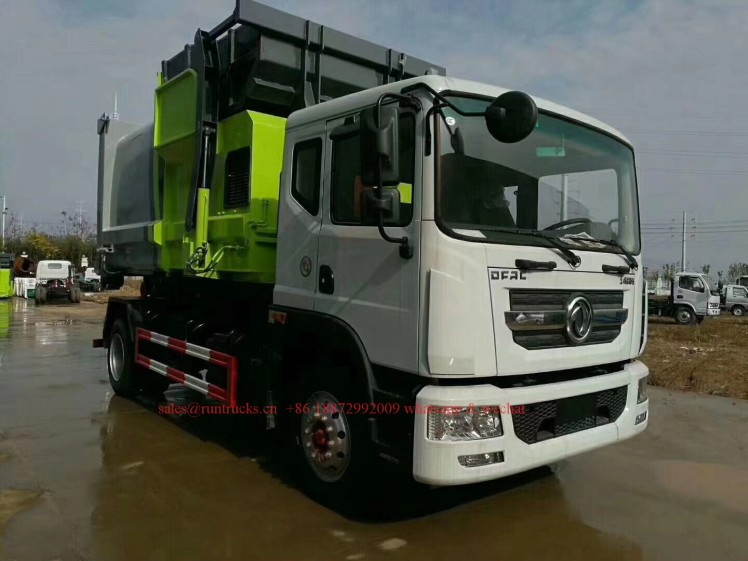 China hook arm garbage truck with Compressed Garbage station 09.jpg
