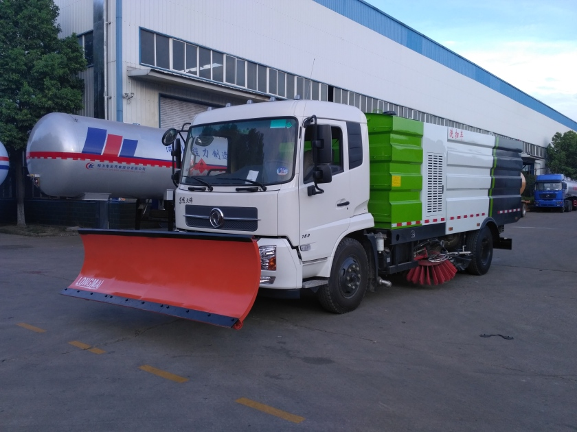 Dongfeng sweeper truck with 3.3m snow removal shovel.
