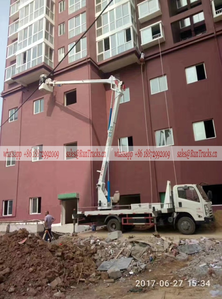 Isuzu 24m aerial work truck assisting for the building painting.jpg