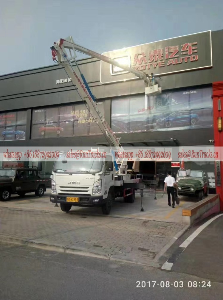 JMC 24m aerial work truck assisting the outdoor advertising for the car shop.jpg
