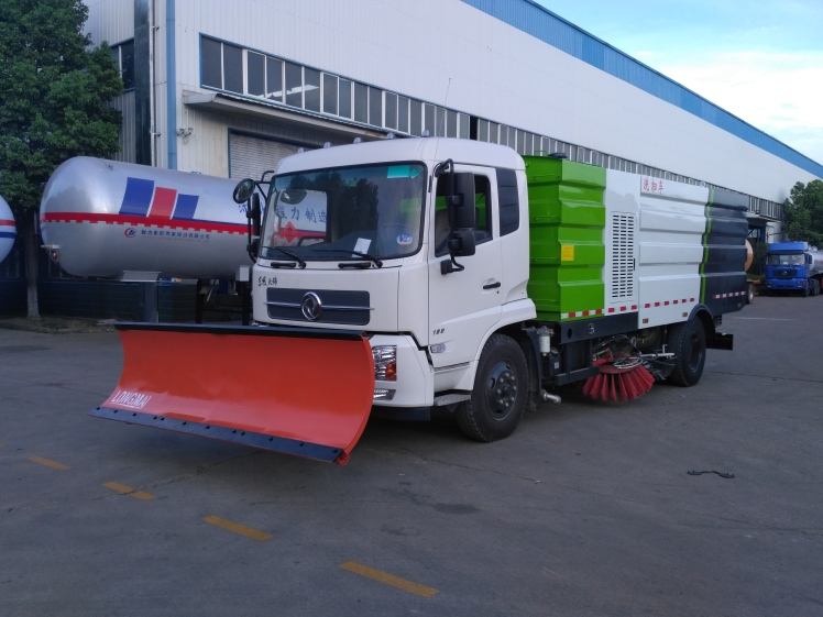 3.0 m longma snow plow on sweeper.jpg